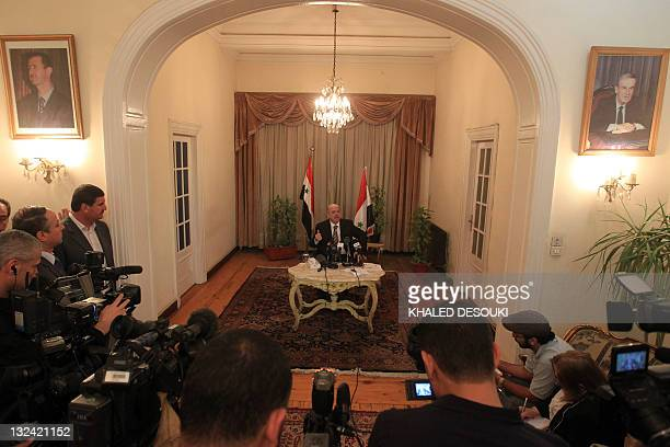 Pictures of Syrian late president Hafez alAssad and his son president Bashar alAssad are seen in the Syria's embassy as Yussef alAhmad Damascus'...