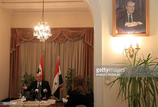 Pictures of Syrian late president Hafez alAssad are seen in the Syria's embassy as Yussef alAhmad Damascus' ambassador to Egypt and the Arab League...