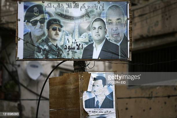 Pictures of Syrian President Bashar alAssad and his father late president Hafez alAssad decorate a street in Jabal Mohsen area of the port city of...
