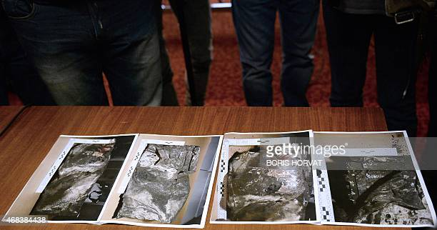 Pictures of the second black box from the Germanwings plane that crashed in the French Alps last week are displayed for journalists during a press...