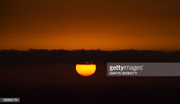 Pictures of the sunset in Vina del Mar about 120 km west of Santiago on February 2013 AFP PHOTO/MARTIN BERNETTI