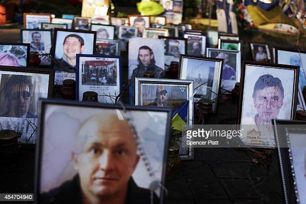 Pictures of Ukrainian protesters who were killed during demonstrations in Independence Square, or Maidan Square, are viewed on September 5, 2014 in...