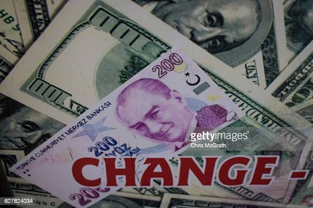 Pictures of US Dollars and Turkish Lira currency are seen on a poster at a currency exchange shop on December 5, 2016 in Istanbul, Turkey. As the...