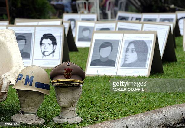 Pictures of victims of the military regime of former Paraguayan dictator Alfredo Stroessner are displayed at the National Pantheon of Heros in...