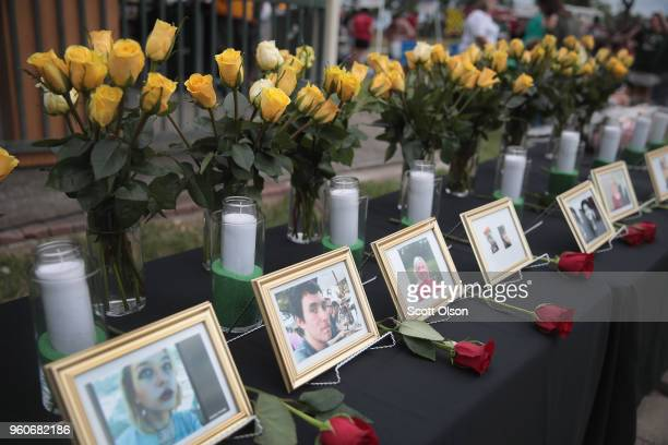 Pictures of victims of the Santa Fe High School shooting are displayed during a prayer vigil at Walter Hall Park on May 20 2018 in League City Texas...