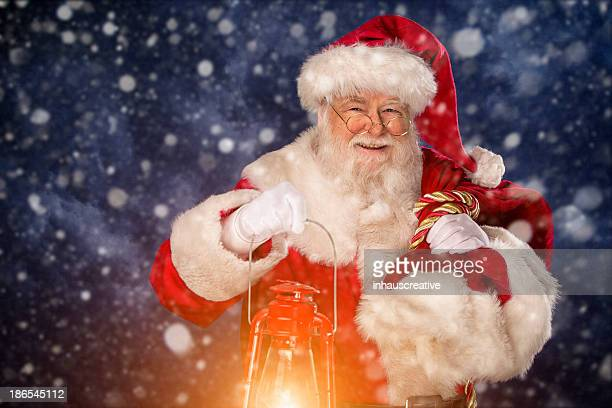 pictures of vintage real santa claus carrying gift sack - santa stock photos and pictures