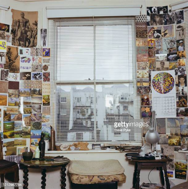 Pictures pinned on a wall at the home of British landscape painter Adrian Berg Brighton East Sussex 30th June 1999