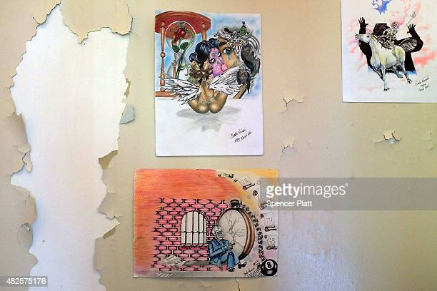 Pictures purportedly made by Charles Manson are on display at a gallery show on Governors Island of work by inmates and former inmates on July 31,...
