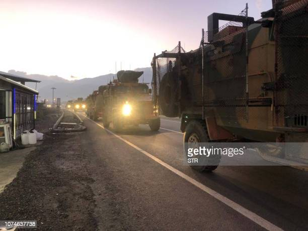 A pictures shows a Turkish military convoy in Kilis at the Syria border on December 22 2018 Turkey has reinforced its military deployment near the...