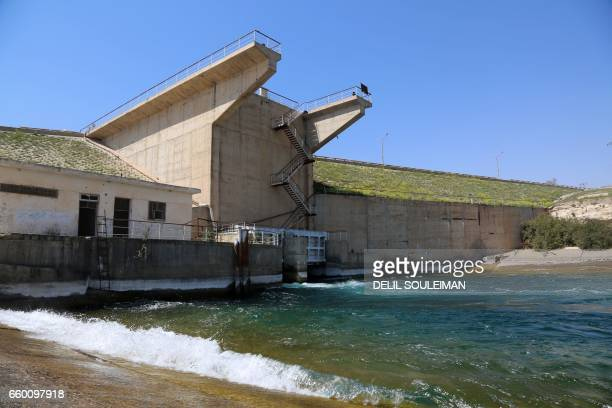A pictures shows on March 29 2017 the Tabqa dam which has been recently partially recaptured by USbacked Syrian Democratic Forces as part of their...