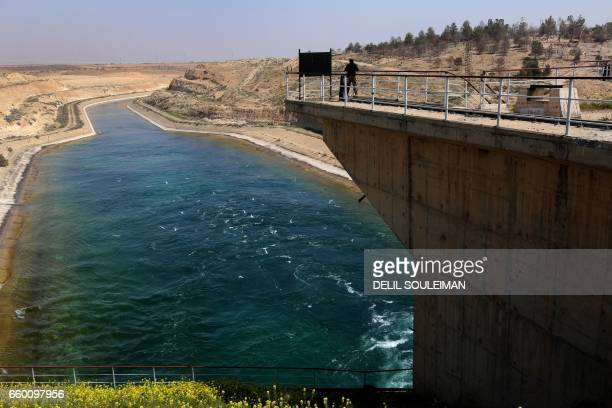 TOPSHOT A pictures shows on March 29 2017 the Tabqa dam which has been recently partially recaptured by USbacked Syrian Democratic Forces as part of...