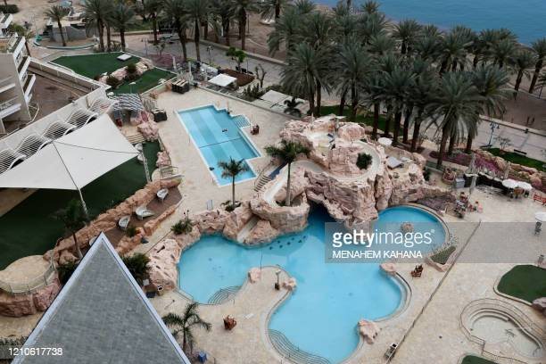 A pictures shows the empty swimming pools of the closed Dan Eilat hotel in southern Israeli Red Sea resort city of Eilat on April 17 2020 amid the...
