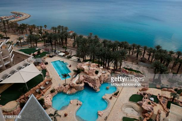Pictures shows the empty swimming pools of the closed Dan Eilat hotel in southern Israeli Red Sea resort city of Eilat on April 17, 2020 amid the...