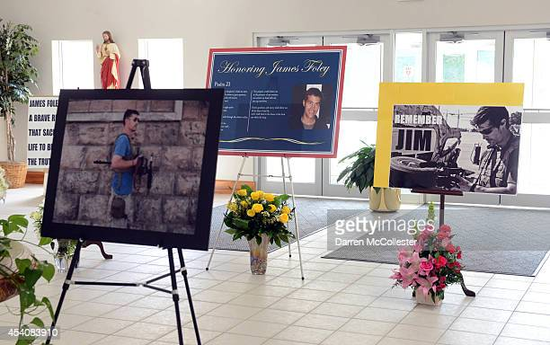 Pictures stand at Our Lady of the Rosary Church for a special mass in remembrance of journalist James Foley August 24 2014 in Rochester New Hampshire...