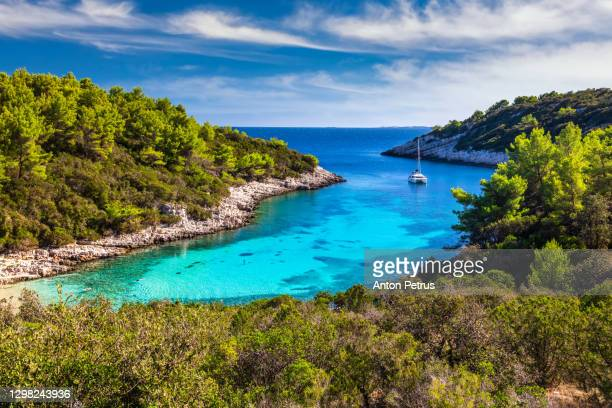 picturesque bay with clean and clear water at hvar island, croatia - balkans stock pictures, royalty-free photos & images
