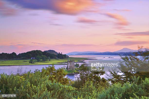 Picturesque Castle Stalker on Loch Laich at twilight in Highlands of Scotland.