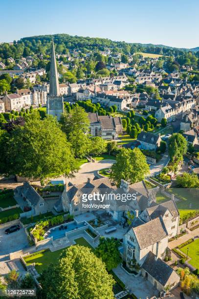 picturesque country village church spire painswick cotswolds summer aerial photograph - overhemd en stropdas stock pictures, royalty-free photos & images