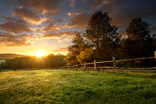 Picturesque landscape, fenced ranch at sunrise 522961501