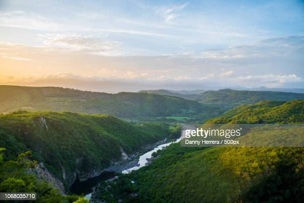 picturesque landscape with river and forest on hills - honduras stock pictures, royalty-free photos & images
