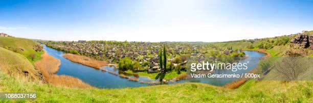 Picturesque landscape with river and village on island