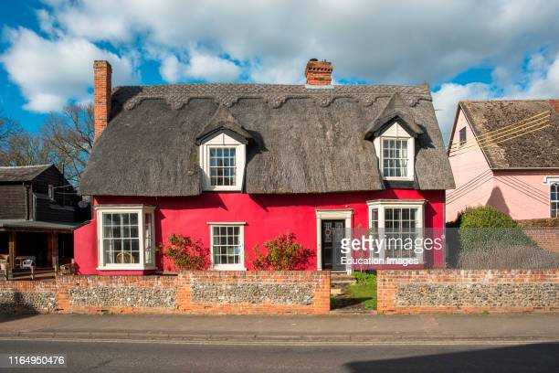 Picturesque red thatched cottage at Cavendish village in Suffolk East Anglia England UK