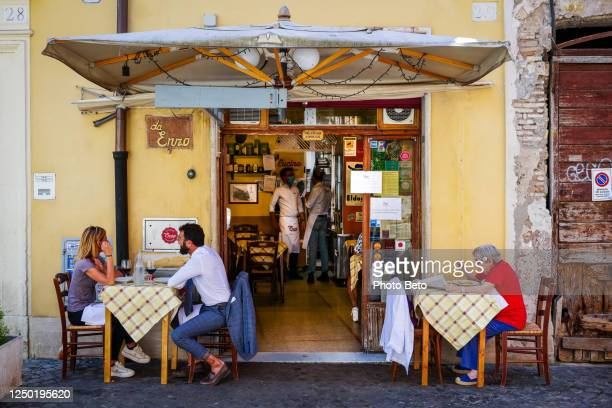 a typical restaurant in the ancient district of trastevere in rome - pizzeria stock pictures, royalty-free photos & images