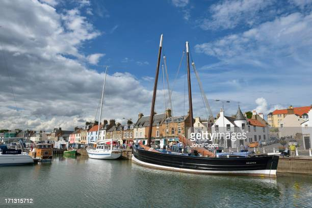 picturesque scene of boats in a scottish harbour - johnfscott stock pictures, royalty-free photos & images