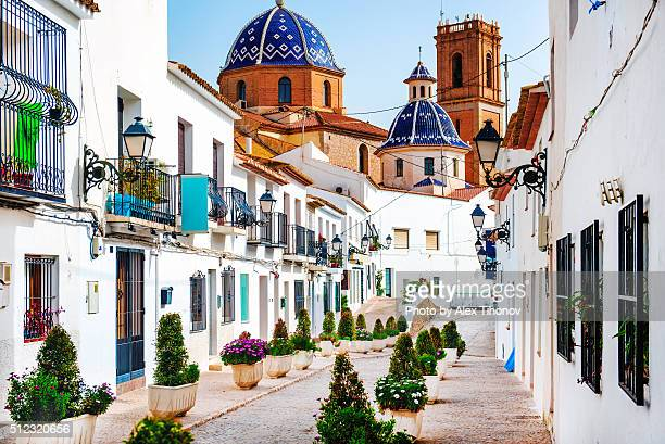 picturesque street of altea town - valencia spanje stockfoto's en -beelden
