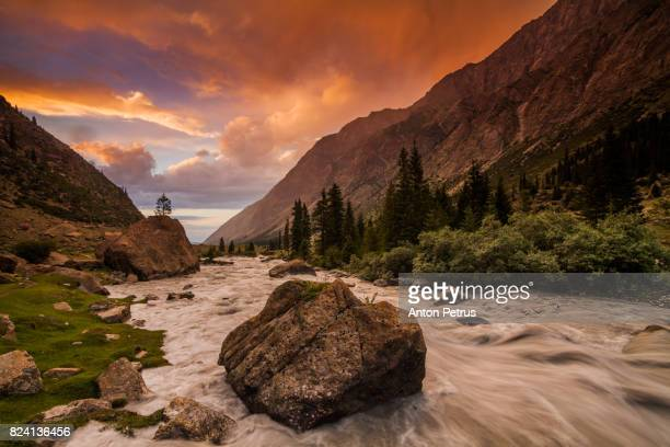picturesque sunset in the barskoon gorge, kyrgyzstan - kyrgyzstan stock photos and pictures