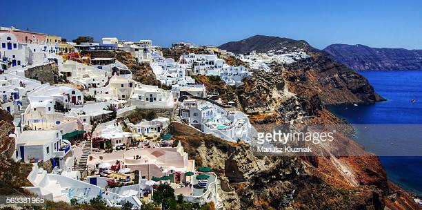 Picturesque town on Santorini caldera cliff top
