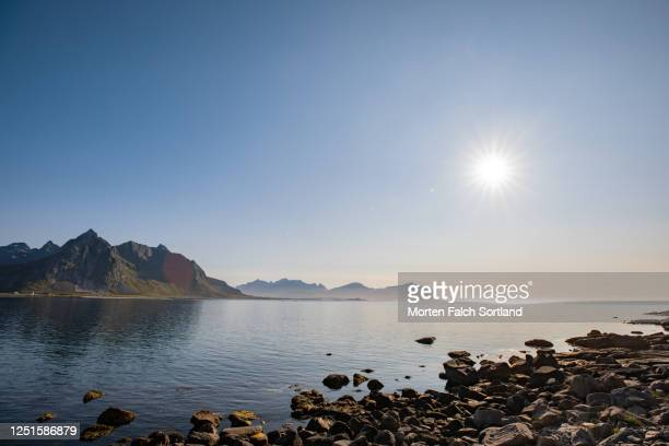 picturesque view of mountains overlooking the sea - rocky coastline stock pictures, royalty-free photos & images