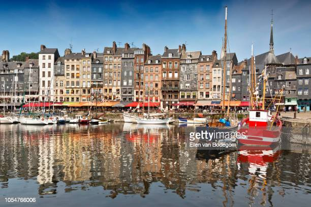 picturesque view over the old port in honfleur on a sunny day in summer - カルヴァドス県 ストックフォトと画像