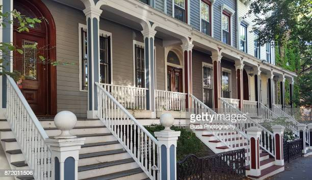 picturesque wooden row-houses in the clinton hill area of brooklyn, new york city - fort greene stock pictures, royalty-free photos & images