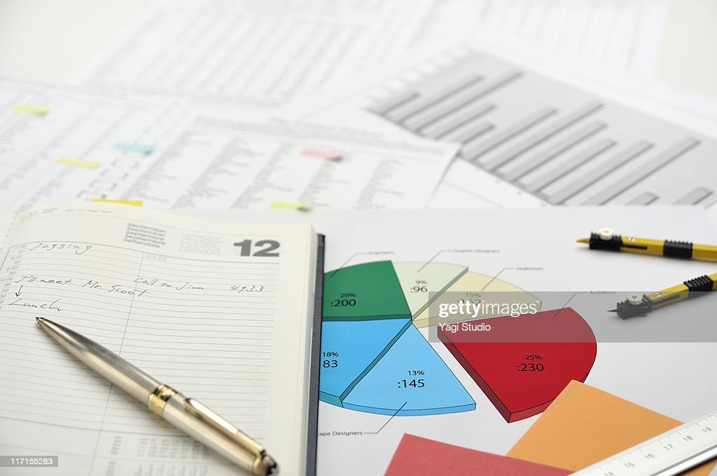 Pie chart and schedule notebook : Stock Photo