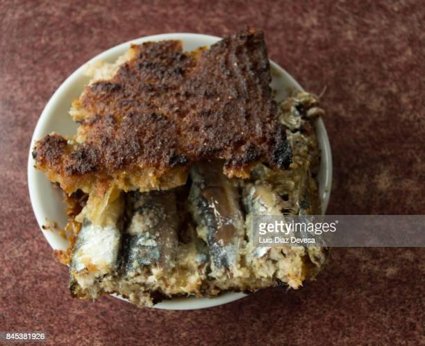 Pie of maize and small sardines, ( empanada gallega )