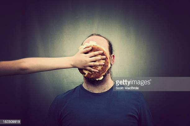 pie on face - scott macbride stock pictures, royalty-free photos & images