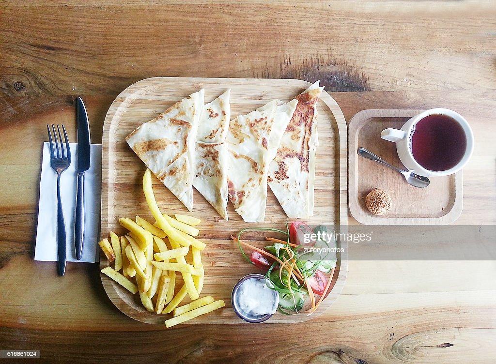 Pie, potatoes, gravy, salad and tea : Stock Photo