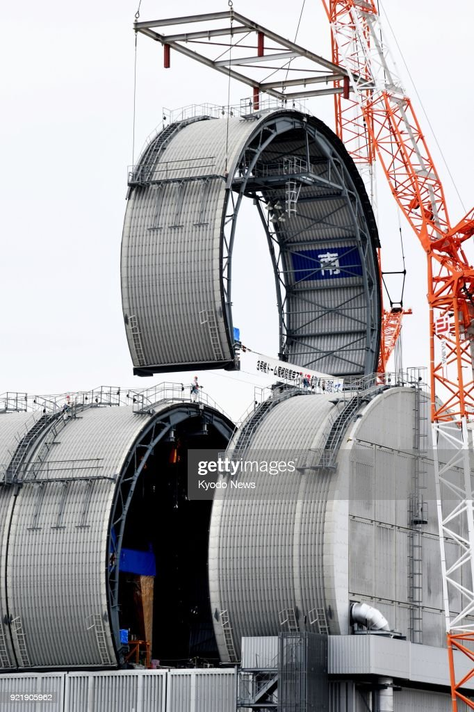 A piece of a domed roof is being installed on the No. 3 reactor building of the crippled Fukushima Daiichi nuclear power plant in Fukushima Prefecture on Feb. 21, 2018. The construction of the roof was completed ahead of the removal of spent fuel from a pool in the building. ==Kyodo