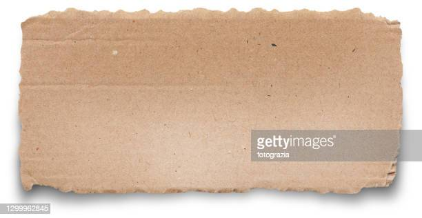 piece of a torn cardboard isolated on white - torn stock pictures, royalty-free photos & images