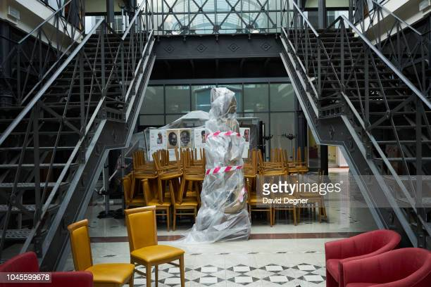 August 22: A piece of art is protected in plastic as the national library is closed for renovations on August 22, 2018 in Malabo, Equatorial Guinea. .
