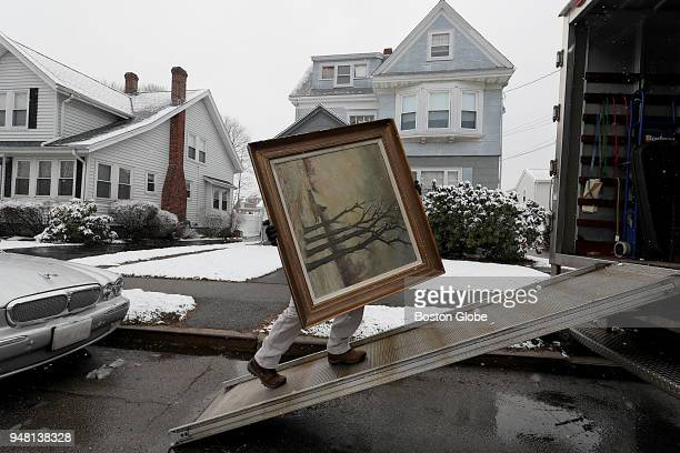 A piece of artwork belonging to James Pantages is loaded into a truck at his home in Quincy MA on April 2 2018 For many years Pantages spent weekends...