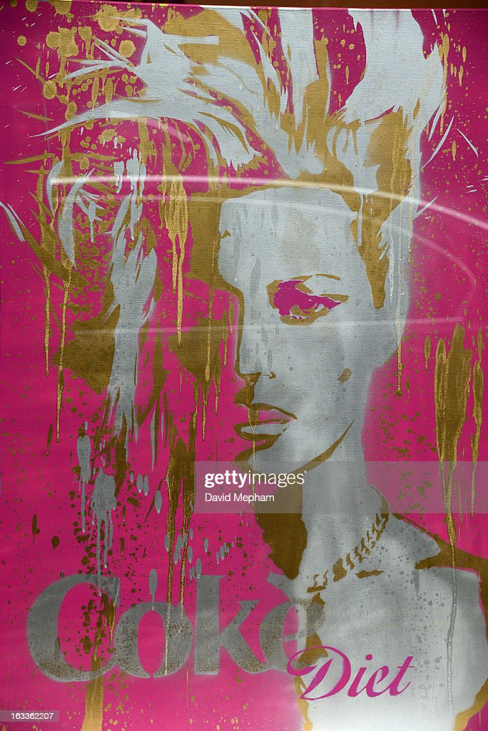 A piece of artwork featuring Kate Moss is displayed in a shop window in Notting Hill on March 8, 2013 in London, England.