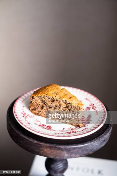 piece of banana cake with walnuts on a plate, selective focus - banana loaf stockfoto's en -beelden