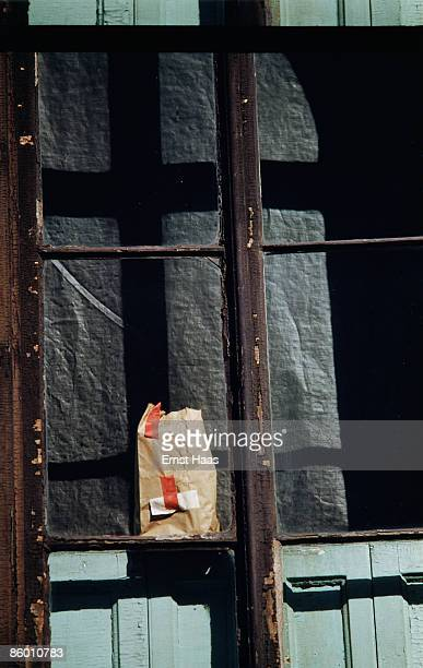 A piece of brown paper taped to a window in New York City circa 1970