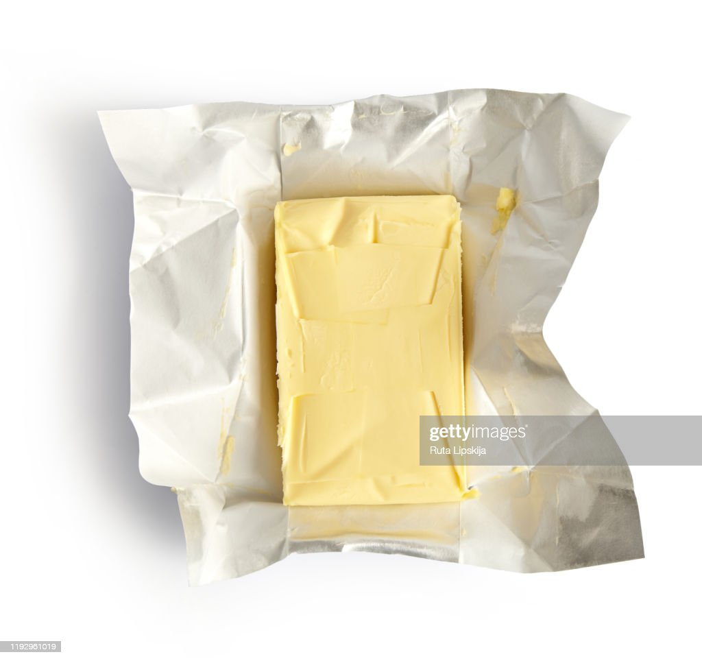 Piece of butter isolated on white background, top view : Stock Photo