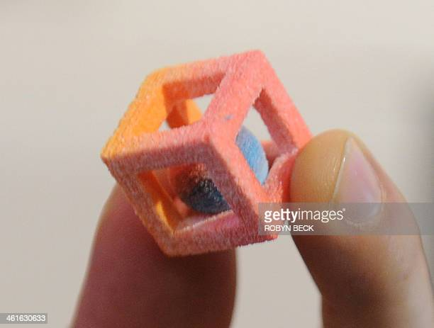 A piece of candy made in a 3D food printer is displayed at the 2014 International CES January 9 2014 in Las Vegas Nevada The candy was printed in the...
