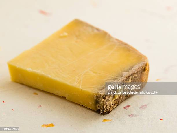piece of cantal cheese. - cantal stock pictures, royalty-free photos & images