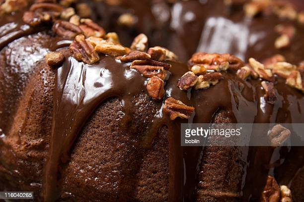 A piece of chocolate cake with nuts for a topping