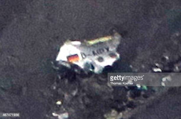 A piece of debris of Germanwings Flight 4U9525 with german flag on it is seen at the crash site in the French Alps on March 24 2015 near Barcelonette...