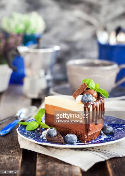 Piece of delicious three chocolate mousse cake